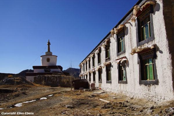 Old ruined stupa and new stupa at Narthang Monastery