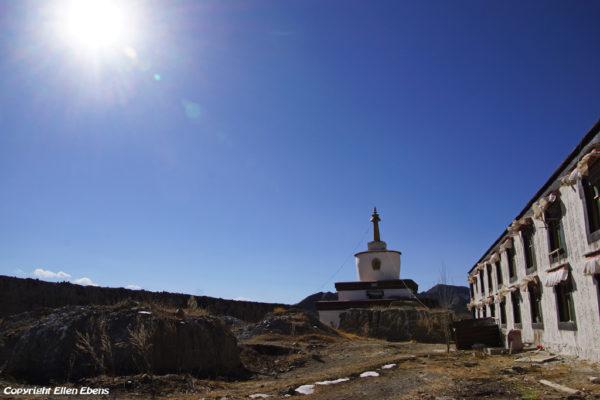 Old ruined stupas and new stupa at Narthang Monastery