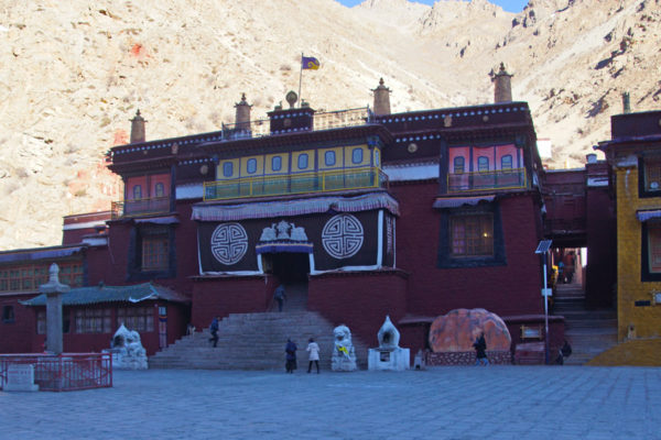 The main assembly hall of Tsurphu Monastery still in the shadow on a cold winter morning. Tsurphu is the official seat of the Karmapa. Tsurphu was founded in 1187