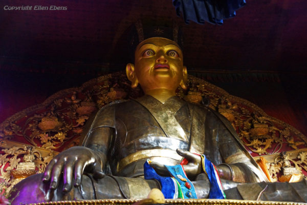 Statue at the main assembly hall of Tsurphu Monastery