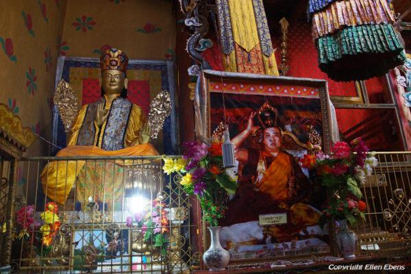 Inside Tsurphu Monastery with apicture of the 16th Karmapa