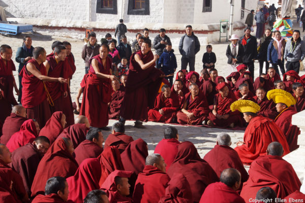 Monks debating at the courtyard in front of the Main Assembly Hall of Drepung Monastery, Lhasa
