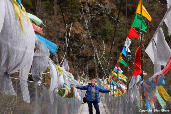 Me between the prayer flags on a traditional bridge in eastern Tibet. January 2018