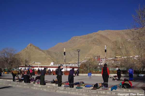 Pilgrims prostrating at the square in front Tashilhunpo Monastery, Shigatse