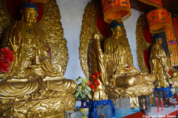 Statues inside the temple on the Island in Fuxian Lake