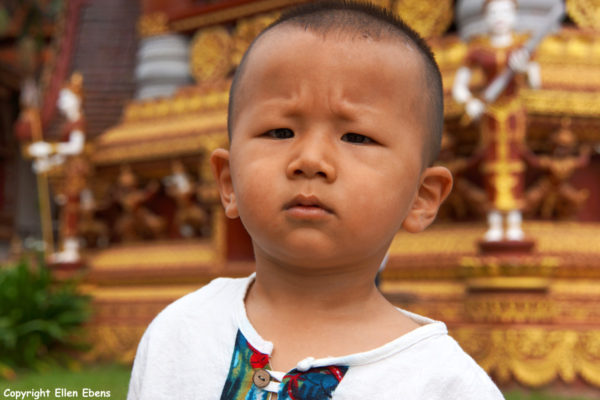 Little boy at the big Buddhist Temple at Manting Park