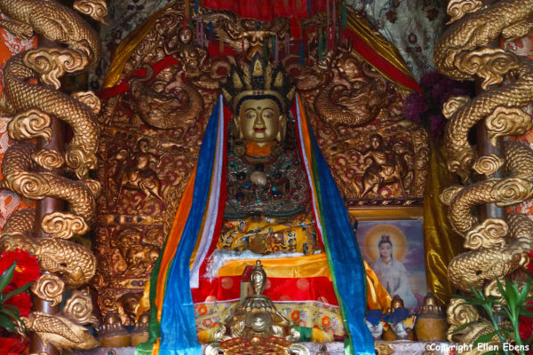 One of the many temple complexes on Jizu Shan, Tibetan temple with Buddha statue