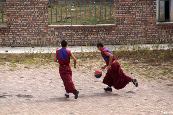Young monks enjoying a game of basketball. Kyangtsang Monastery, Shanba village (near Songpan)