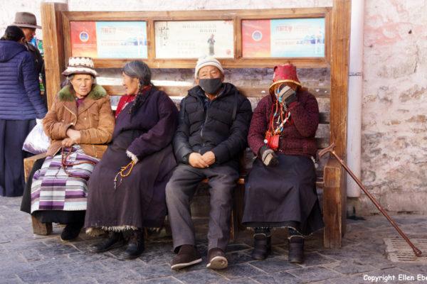 Lhasa, Barkhor street. Elderly pilgrims taking a rest.