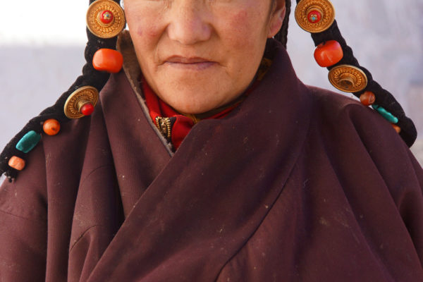 Lhasa, portrait of a woman climbing up the stairs to the Potala Palace.