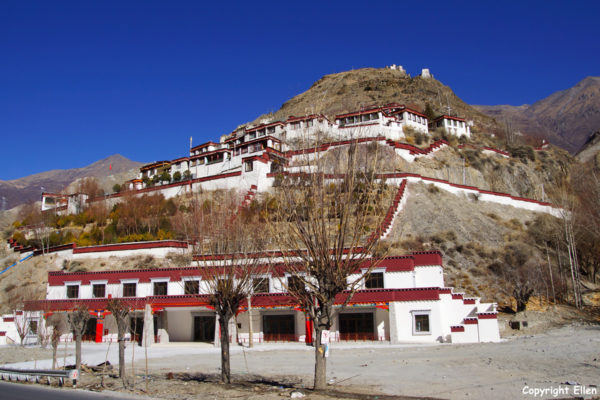 Driving from Nanxiang to Tsedang. Monastery next to the road.