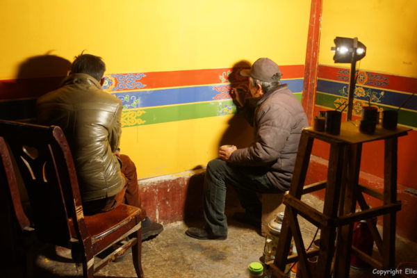 Painting the wall at the Tandruk Temple near the town of Tsedang