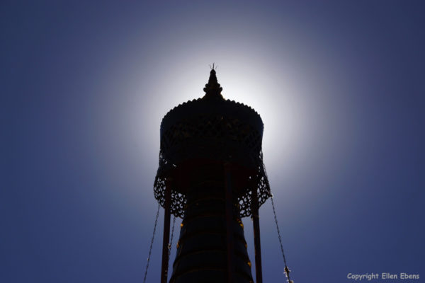 The sun shining behind a stupa at Rabse Nunnery, Gyantse