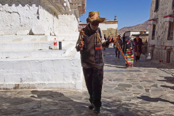 Pilgrims walking the kora around the stupas of Tashilhunpo Monastery, Shigatse