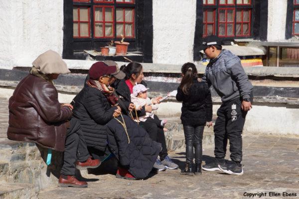 Pilgrims taking a rest inside Tashilhunpo Monastery, Shigatse
