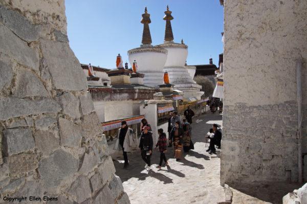Pilgrims walking the kora around the stupas of Tashilhunpo Monastery, Shigatse