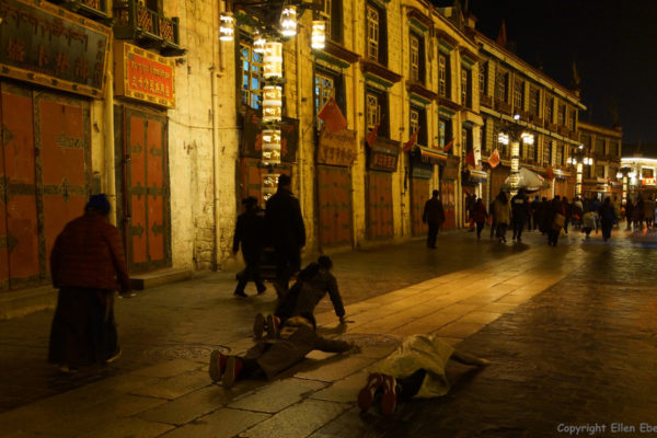Lhasa, pilgrims walking and prostrating at Barkhor Street