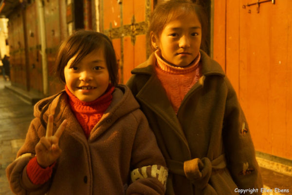 Lhasa, two young girls at Barkhor Street