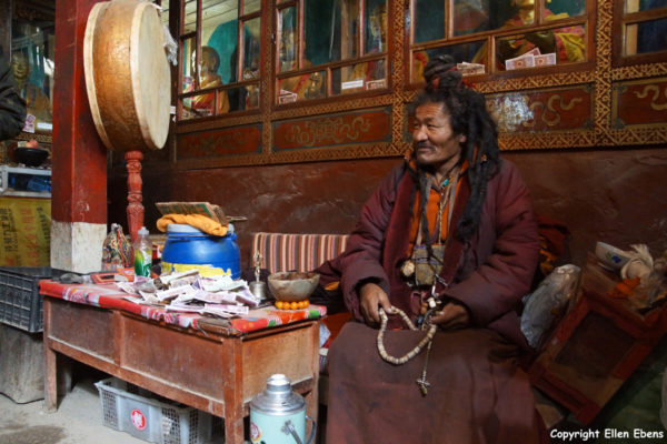 Monk with long hair at Drak Yerpa Meditation Caves. That means this monk meditated for many years.