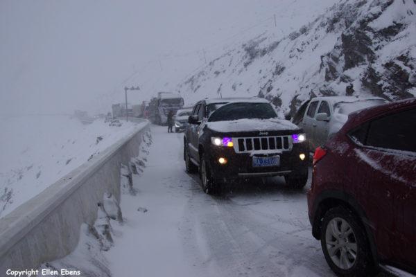 snow traffic jam Zheduo Pass