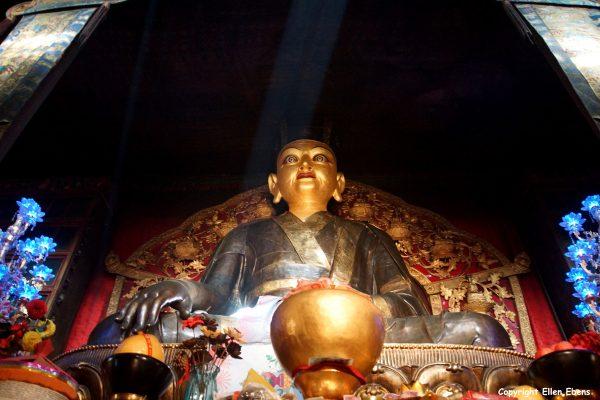 Statue inside Tsurphu Monastery