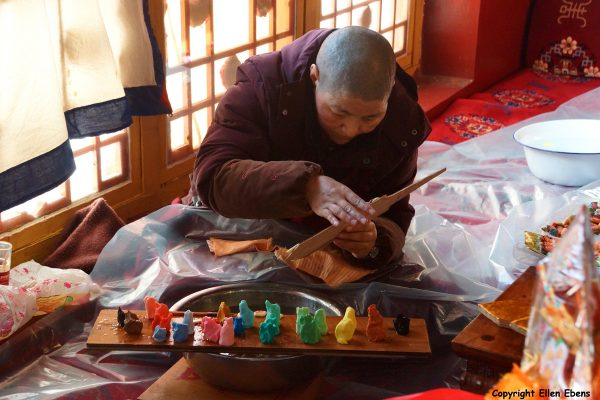 Nun making decorations of yak butter for the Tibetan New Year, Ani Tsankhung Nunnery